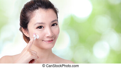 woman washing face with foam on green - Beautiful woman...