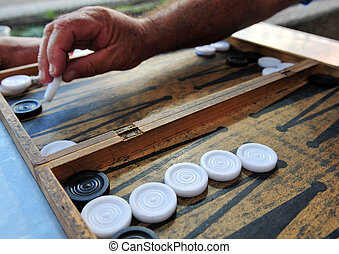 Backgammon - Game - Close up of players hand palys...