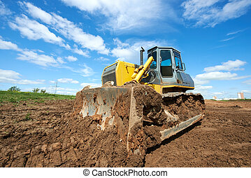 track-type loader bulldozer excavator at work - track-type...
