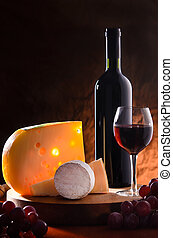 Still-life with cheese, grape and wine.