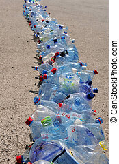 Plastic Recycling - Line of empty plastic bottles for...