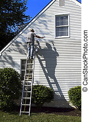 Man Painting and his shadow - Man painting house in late...