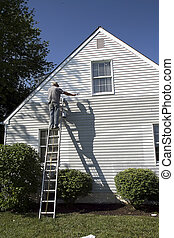 Man Painting Side of House - Man painting side of house...