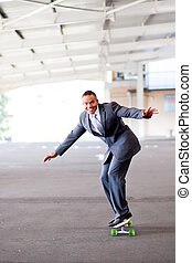 young businessman on skateboard - happy young businessman on...