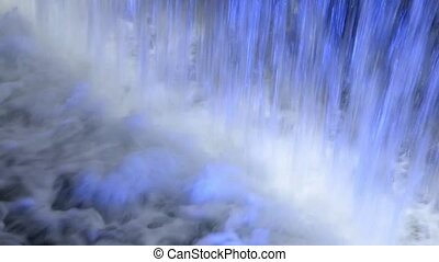 bubbling water fountain at night
