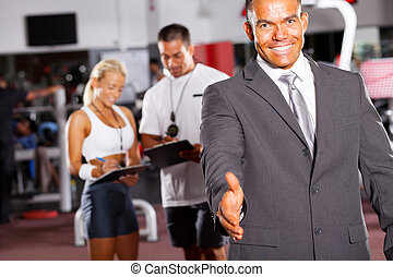 friendly gym manager hand shake gesture