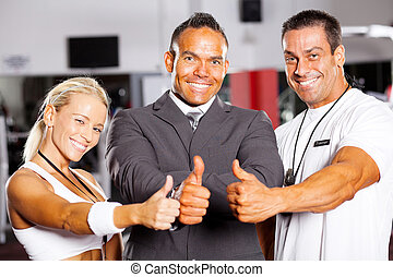 confident gym staff thumbs up