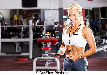 happy young female gym personal trainer