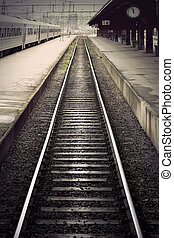 train station - Empty railway track between platforms at...