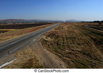 Open Freeway with Sand Road Junction - Open Freeway in Rural...