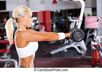 fit woman doing workout with dumbbell