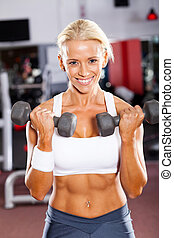 fitness woman exercising with dumbbells in gym
