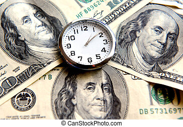 Time Is Money - A clock show the time over three American...