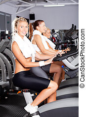 group of girls on gym bike
