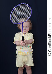 little boy with a racket - The little boy with a racket for...