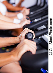 closeup of hands on gym bikes