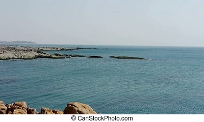 Ocean water surface and rock reef coastal,horizon,skyline.