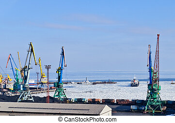 Commercial Sea Port on the ice. Winter ship leaves the port.