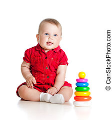 baby girl playing with toy isolated on white background