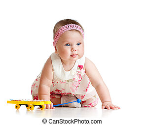 little child girl playing musical toy