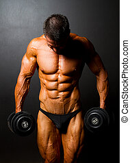 bodybuilder with dumbbells on black background