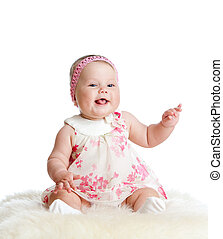 cute baby girl sitting and smiling