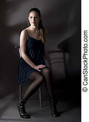 beauty  brunette sitting on a chair