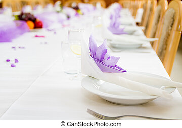 Violet wedding or reception table ready for meal