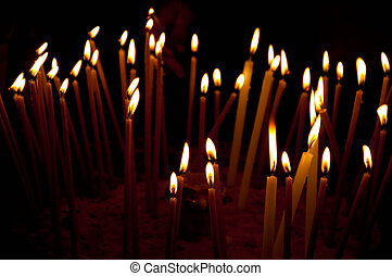 Burning candles in the temple, sacred fire