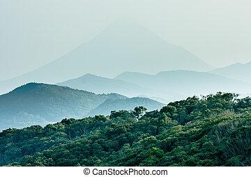 Layered hills with Mount Kaimon (Kaimondake) in the...