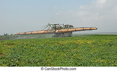 Tractor spraying insecticide