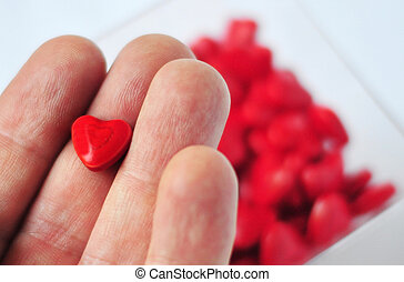 Love Pills - Man hand holds sweet heart