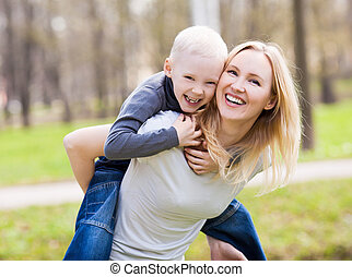 mother and son - happy family; young mother and her six year...