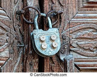 Ancient wooden door - Wooden door with ancient floral...