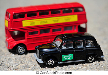 London Bus and Black Taxi - A bright red traditional London...