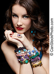 beautiful woman in jewelry - portrait of young beautiful...