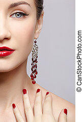 beautiful woman in ear-rings - close-up portrait of young...