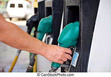 Fuel Station - A person fuel his vehicle in a fueling...