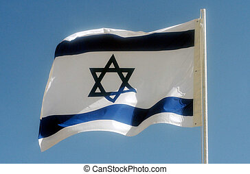 Israel Flag - One Israeli national flag against blue sky.