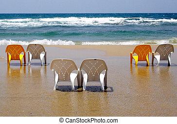 Beach Chairs - Empty beach chairs along the sea shore.