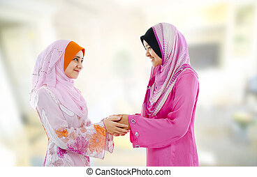 Muslim greeting - Muslim woman in traditional clothing...