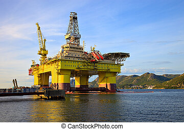 Oil rig near the mountains in Norway