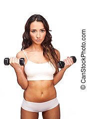 Sexy woman working out with dumbbells