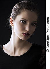 fashion low key portrait, she is turned of three quarters -...