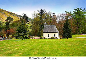 Springtime landscape with an old, white chapel, Scotland