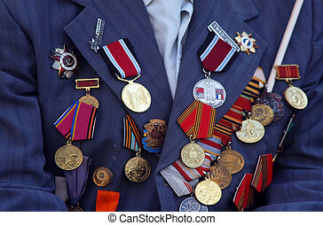 War Medals - Many war military medals on a army uniform.