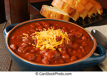 Chili con carne with cheese - A crock of chili with shredded...