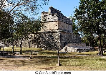 Mayan Ruin Among Trees at Chichen Itza - Ruin of a small...