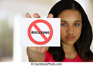 Anti Bullying - Teen girl holding a card that says no...