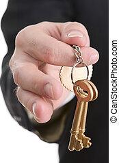 Golden keys series - Success secret - A hand holding a pair...